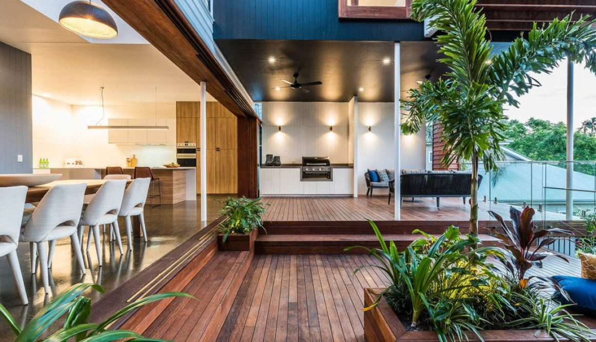 Timber deck with open plan home and plants