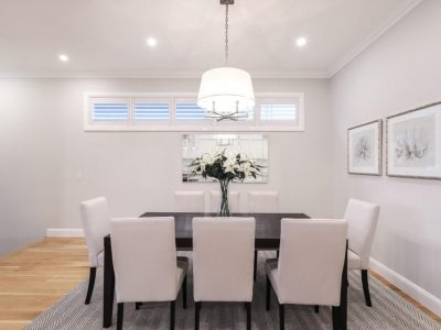 Black dining table with cream chairs