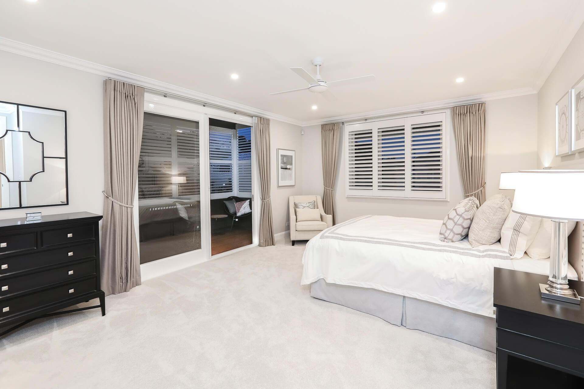 Master bedroom with doors to sun room