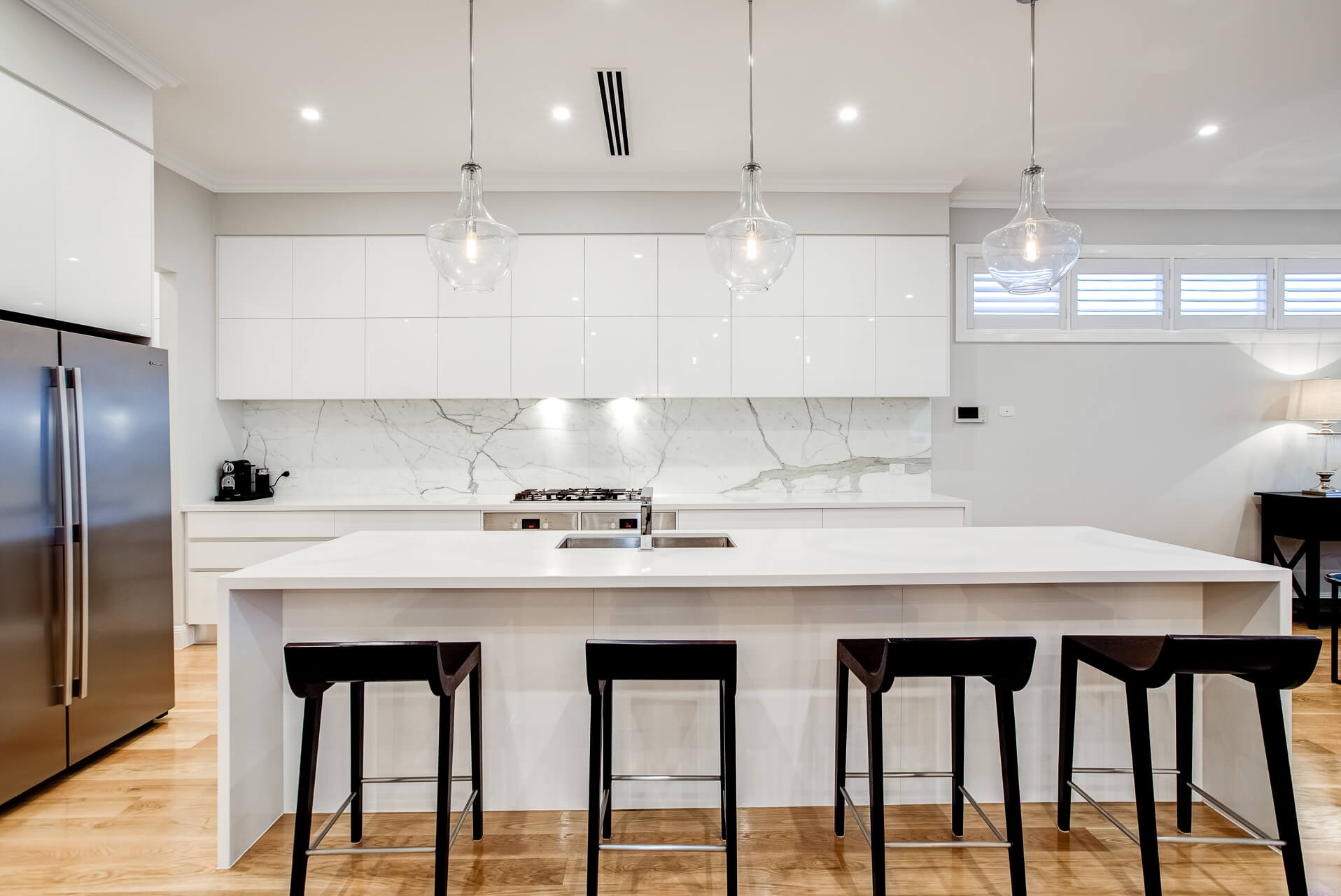 Large kitchen with marble splashback