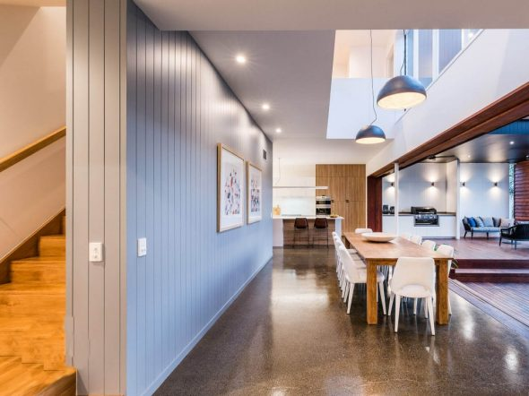 Indoor dining area with pendent lights and grey walls