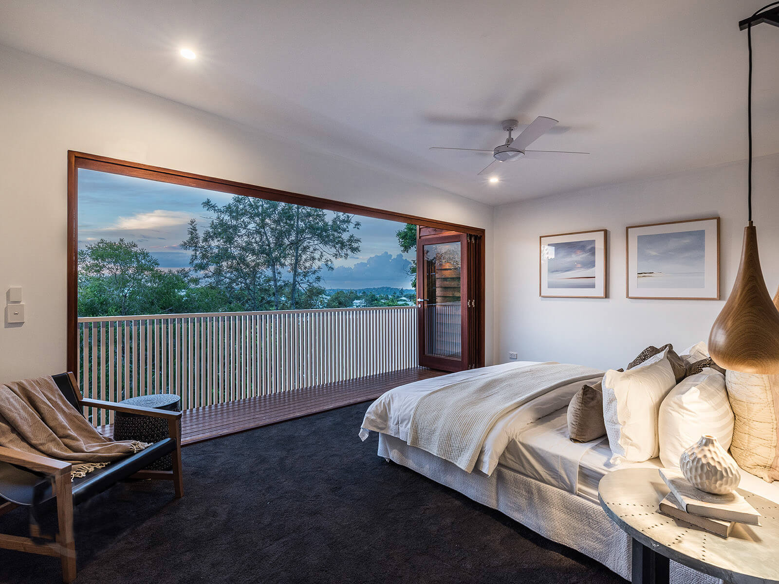Carpeted bedroom with deck and views