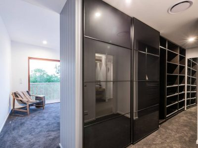 Walk-in wardrobe with black cupboards