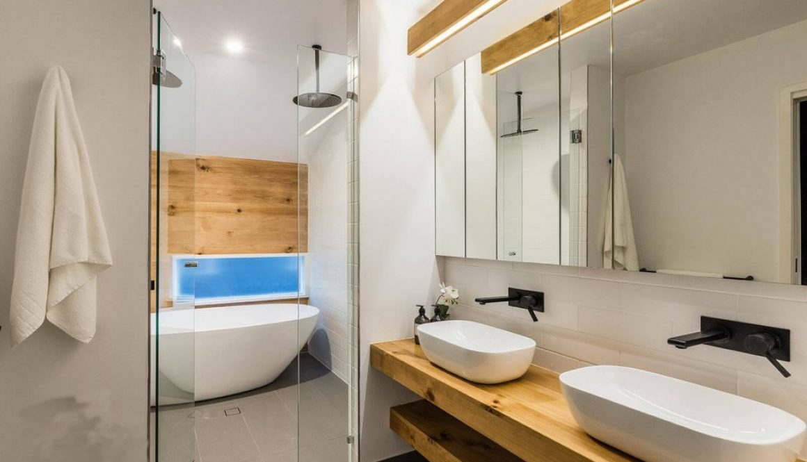 Bathroom with twin sinks, shower and bath tub with timber
