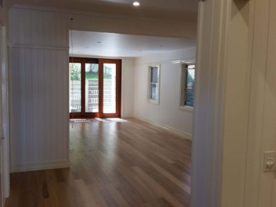 Timber floors, white walls and glass sliding doors