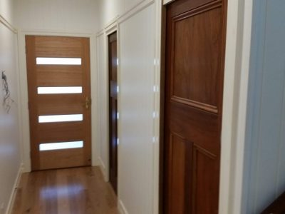 Entryway with timber doors