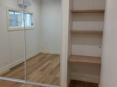 Shelves, desk space and mirrored wardrobe