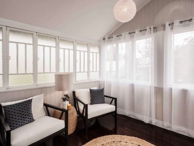 Front room with chairs and windows